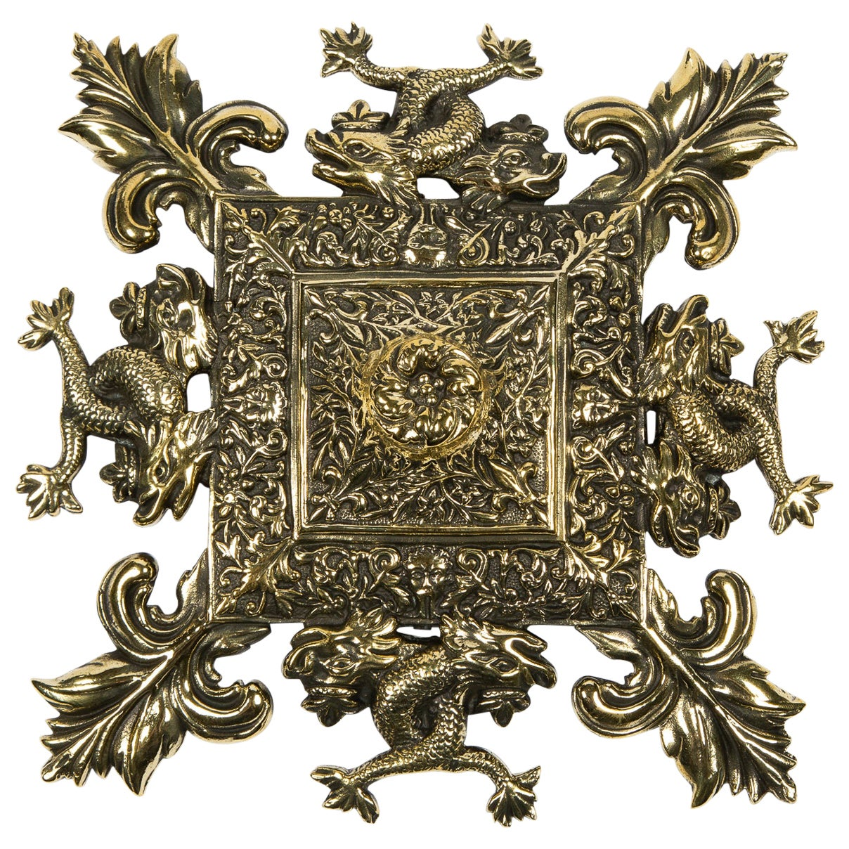 Brass Wall Plaque Decorated with Intertwined Sea Serpents and Fleur-de-Lis