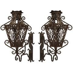 Pair of Turn of the Century Italian Renaissance Style Wrought Iron Wall Lanterns