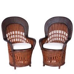 Midcentury Pair of British Colonial Style Wicker and Reed Peacock Chairs