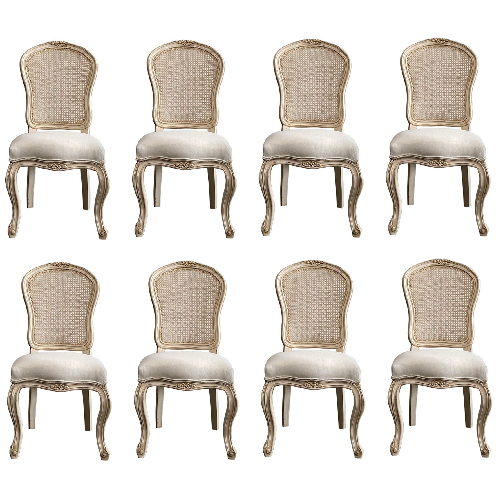 Set of 8 French Louis XV Style Painted and Upholstered Cane Back Chairs