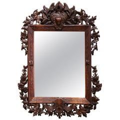 19th Century French Black Forest Carved Walnut Wall Mirror with Foliage Motifs