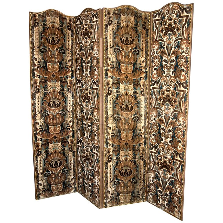 A Continental Antique Textile Covered Four Fold Screens