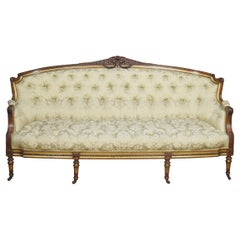 19th Century Carved Walnut and Parcel Gilt Sofa
