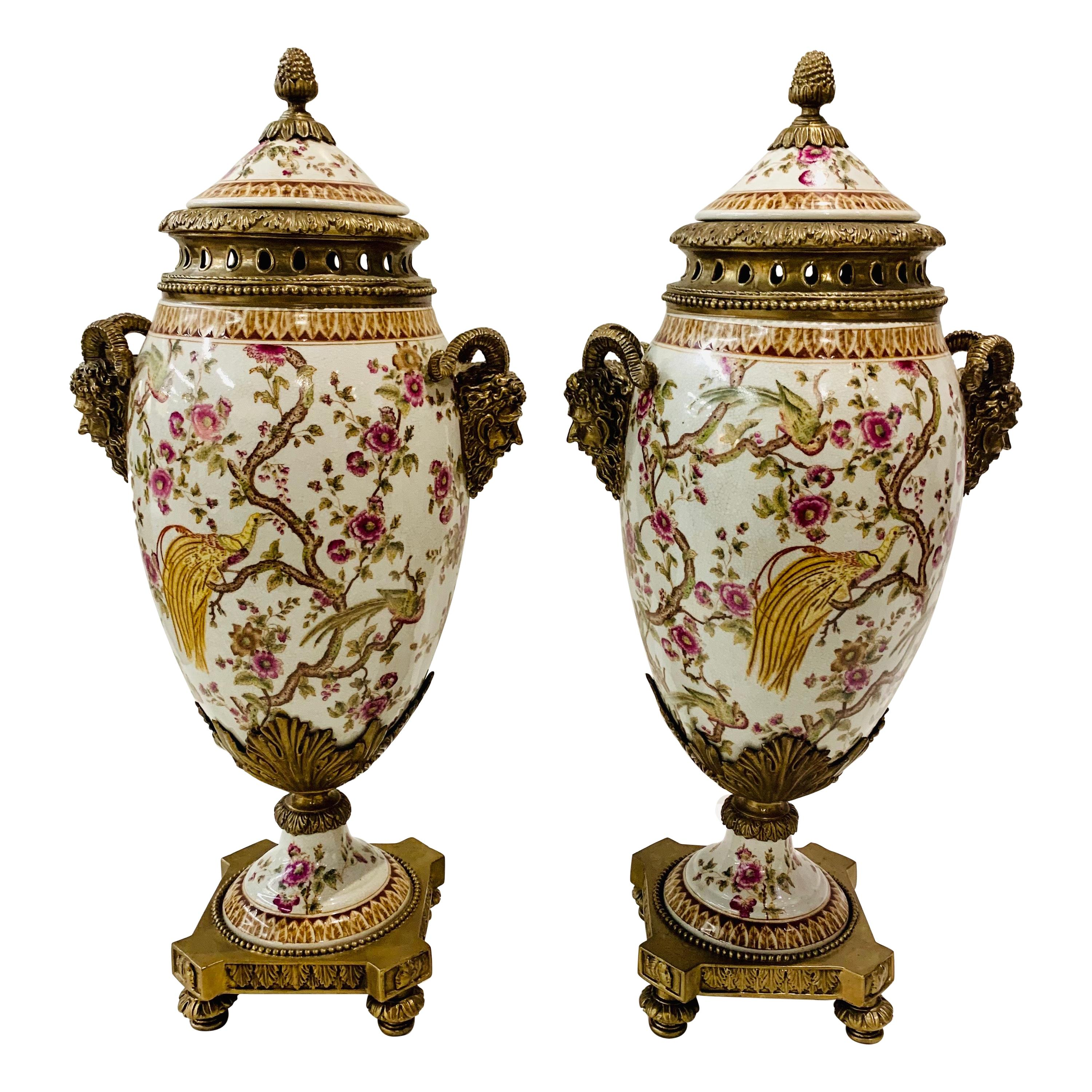 Porcelain and Bronze Covered Urns with Figural Ram's Head Handles