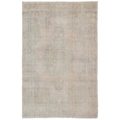 Muted Vintage Turkish Rug in Cream, Gray, Camel and Light Brown Colors