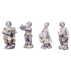 Set of Four Early 20th Century Dutch Hand Painted Porcelain Delft Figurines