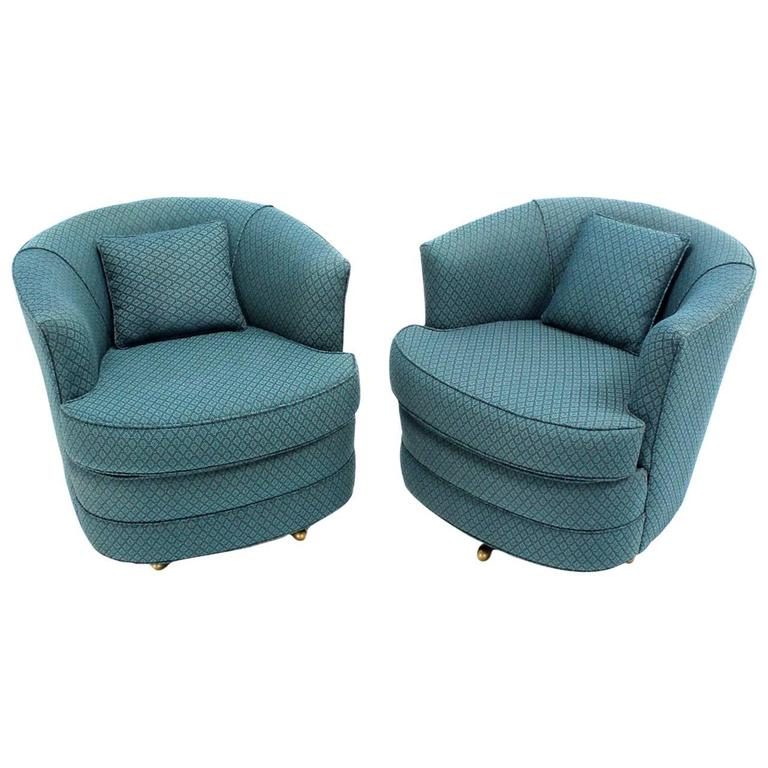 Pair of swivel barrel lounge chairs at 1stdibs