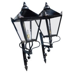 Pair of American Wrought Iron and Spelter Finial Mounted Wall Lanterns, C. 1850