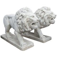 Two Cast Cement or Concrete Walking Lions