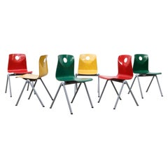 Multi-Colored Stacking Chairs with Circle Cut out