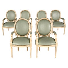 Group of Six Louis XVI Style Painted and upholstered Oval Back Armchairs, 20th C