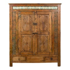 Indonesian 19th Century Cabinet with Sunburst Motifs and Enameled Tiles