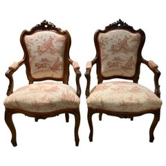 Pair Louis XV-Style Arm Chairs in Walnut with Carved Cartouche Toile Upholstery