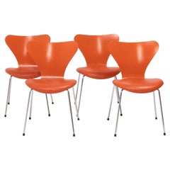 Fritz Hansen by Arne Jacobsen Orange Leather Series 7 Dining Chairs, Set of 4