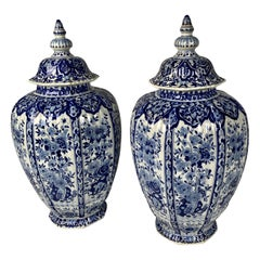 Pair of Large Blue and White Delft Jars Decorated with Flowers