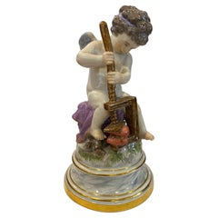 19th Century Meissen Porcelain Figure of Cupid with a Cheese Press