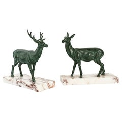French Pair of Art Déco Bronze Boodends, Green Deers in Motion, 1940s
