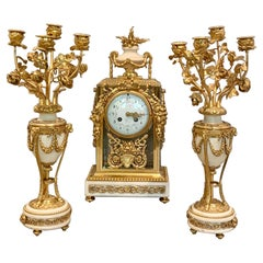 Fine French Gilt Bronze Four Glass Clock Set by Gerard, Paris Early 19th Century