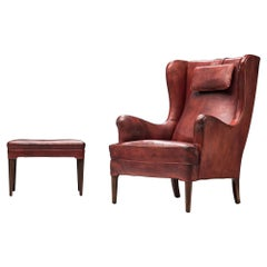 Frits Henningsen Lounge Chair with Ottoman in Original Burgundy Leather