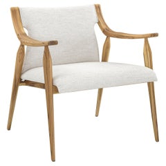 Mince Armchair Featuring Curved Arms, Spindle Legs & Light Fabric