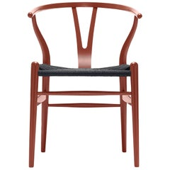 CH24 Wishbone Chair in Red Brown with Black Papercord Seat by Hans Wegner