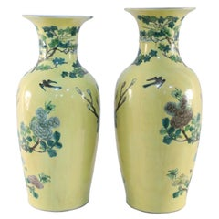 Pair of Chinese Yellow and Natural Scene Vases