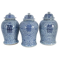 Chinese White and Blue Floral Lidded Urns