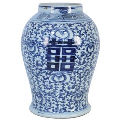 Chinese White and Blue Character and Floral Urn