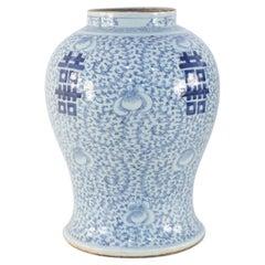 Chinese Off-White and Light Blue Vine Motif Porcelain Urn Vase