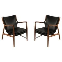 Pair of Finn Juhl Mid-Century Danish Teak and Black Leather 45 Armchairs