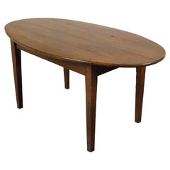 English 19th Century Walnut Table with Oval Top, Tapered Legs and Dark Patina
