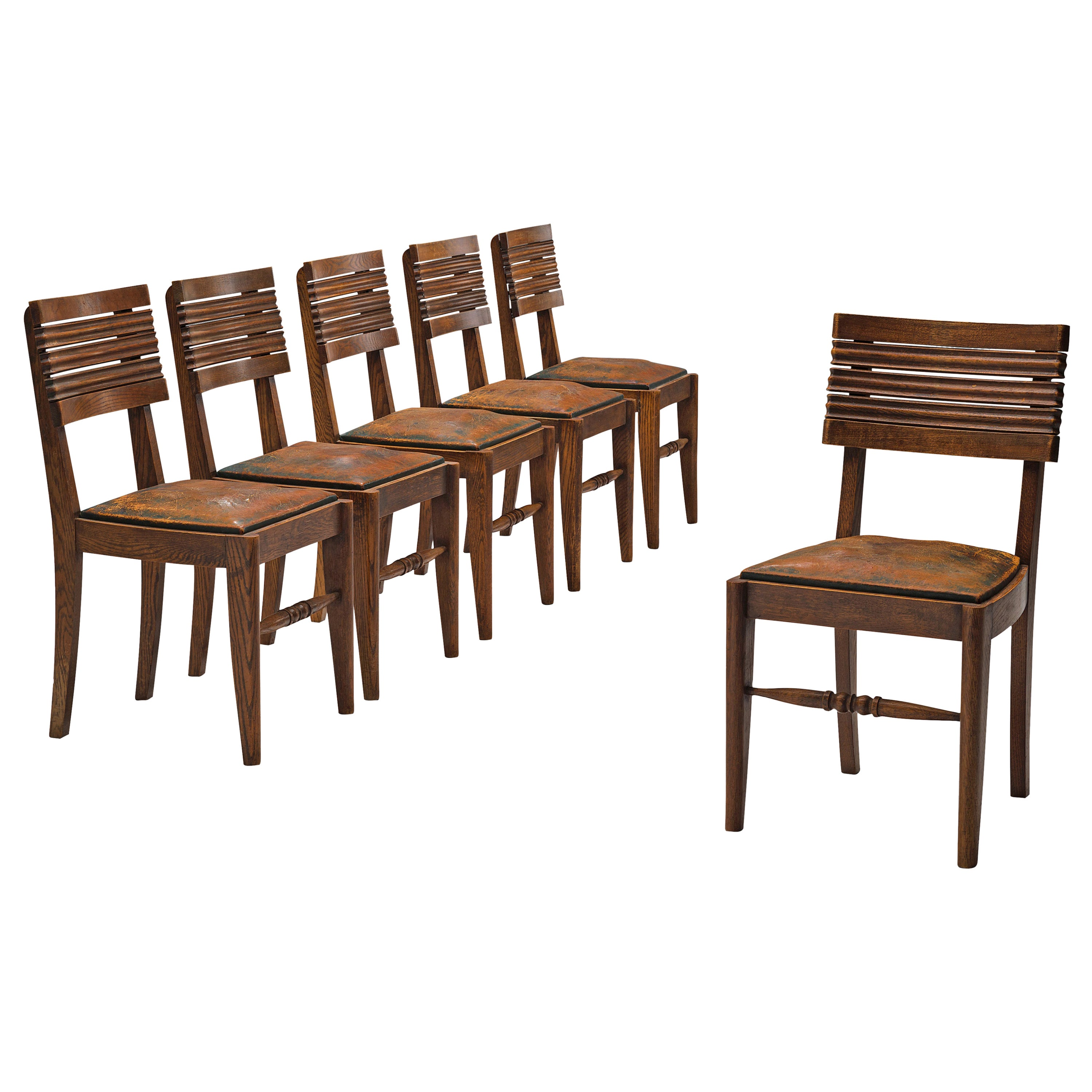 Gaston Poisson Set of Six Dining Chairs in Oak and Leather