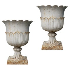 Two Reclaimed Antique Cast Iron Urns
