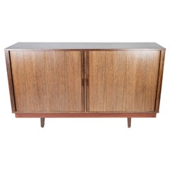 Low Sideboard with Sliding Doors in Rosewood of Danish Design from the 1960s