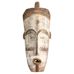 Tall Wooden Tribal Fang Mask of Ngil Brown, Creme and Red Colored Gabon 1970s