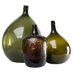 Set of Three 19th Century Italian Blown Demijohn or Damigiana Glass Bottles