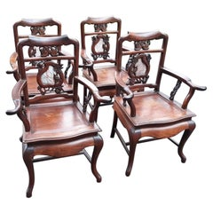 Set of Four Hand Carved Chinese Armchairs