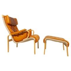 Scandinavian Modern Lounge Chair and Stool by Nielaus & Jeki Møbler, 1980s