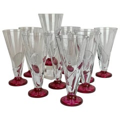Set of Ten Assymetrical Clear Glasses with Cranberry Glass Bases