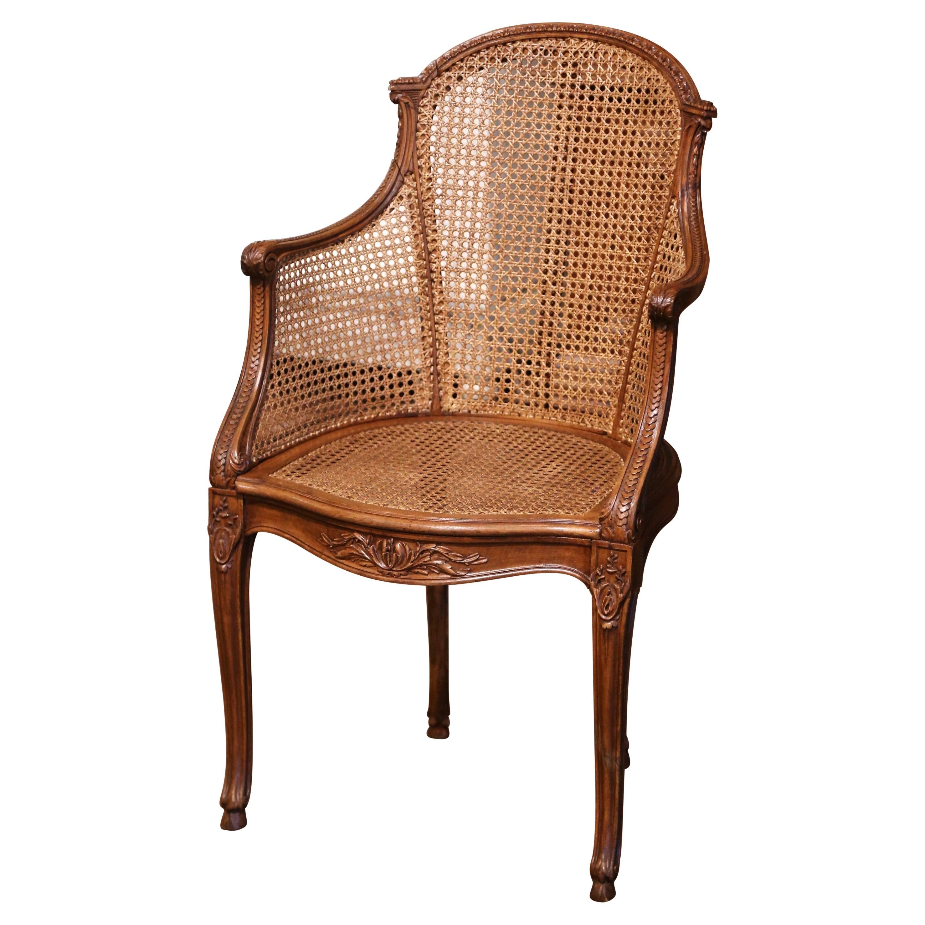 Early 20th Century French Louis XV Carved Walnut and Cane Desk Armchair
