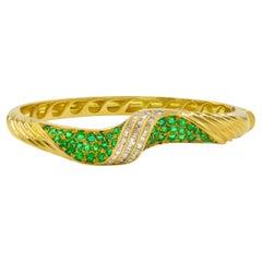 Estate Swirling 18 Karat Yellow Gold, Emerald and Diamond Bracelet