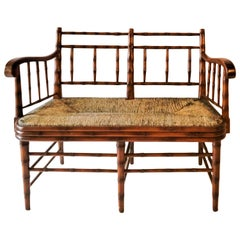 Late 20th Century French Style Faux Bamboo Settee with Rush Seat by Sarreid