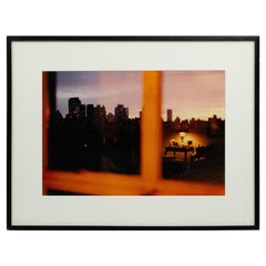 Color Photograph of a Cityscape in a Window