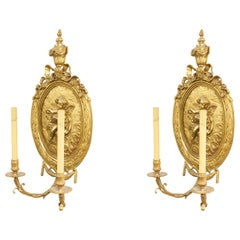 Pair of French Louis XV Style Bronze Dore Cupid Wall Sconces
