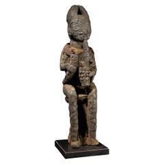 Community Protective Power Figure Covered in Pangolin Scales with Necklace