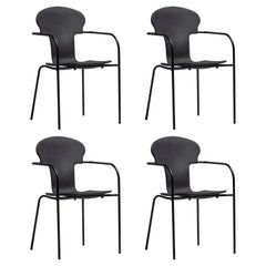 Set of 4 black chairs by Oscar Tusquets