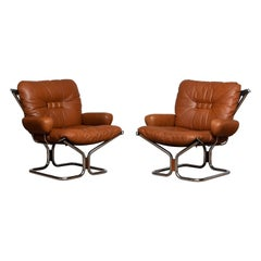 1970s Pair Lounge Chairs in Cognac Leather and Chrome by Harald Relling