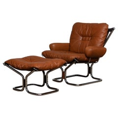 1970 Cognac Leather and Chrome Lounge Chair and Ottoman by Harald Relling
