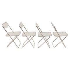 Set of Four Lucite in th style of Giancarlo Piretti's Plia chairs, circa 1970's