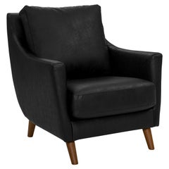 Hug Armchair Upholstered in Black Faux Leather and Oak Solid Wood Legs